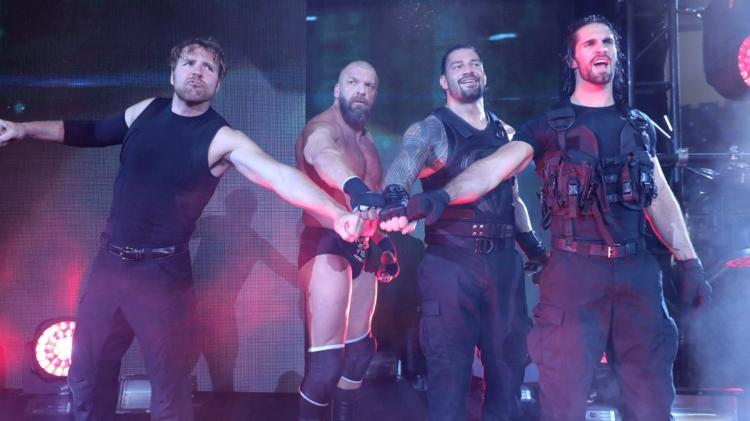 Triple H with Shield Members; Dean Ambrose, Roman Reigns and Seth Rollins.